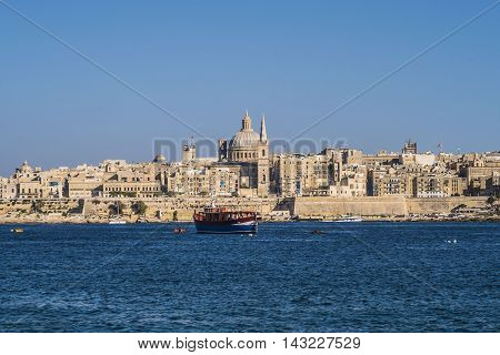 Valletta, Malta. Dome of Roman Catholic Basilica of Our Lady of Mount Carmel.  St Paul's Pro-Cathedral landmark tower also visible. The Basilica is part of the UNESCO World Heritage Site.