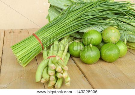 green Lime Yardlong bean Leek and kale on wood floor