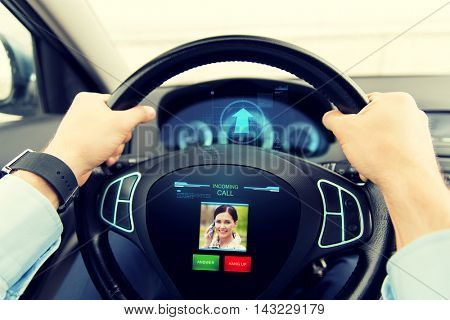 transport, business trip, technology, communication and people concept - close up of male hands holding car wheel and driving with incoming call from woman on board computer screen