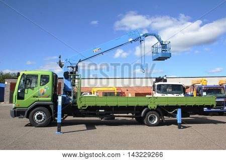 KEMEROVO RUSSIA - MAY 14 2015: Truck crane standing on a construction site
