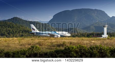 LUANG PRABANGLAO PDR. - NOVEMBER 9 2015: Bangkok Airways - HS-PPB Airbus A319 landing at Luang Prabang International Airport from Suvarnnabhumi International Airport Bangkok Thailand