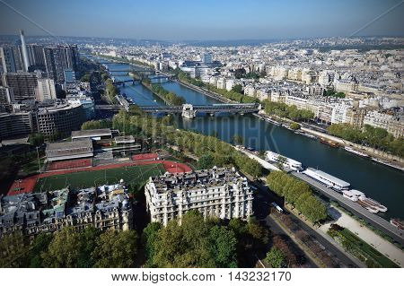 Bird-eye View Of The Seine River In Paris Viewed From The Eiffel Tower