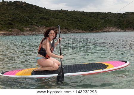 Stand Up Paddle Boarder Finishing A Long Workout On At The Sea