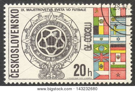 MOSCOW RUSSIA - CIRCA JUNE 2016: a post stamp printed in CZECHOSLOVAKIA shows World Cup Emblem and Flags the series