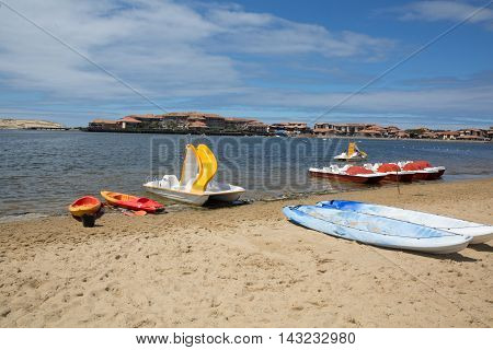Canoe bay colorful boat pedalo in a quiet beach