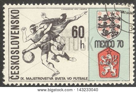 MOSCOW RUSSIA - CIRCA JUNE 2016: a post stamp printed in CZECHOSLOVAKIA shows Two Players and Badges of England and Czechoslovakia the series