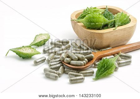 Herb pills with bitter gourd homeopathic medicine on white background
