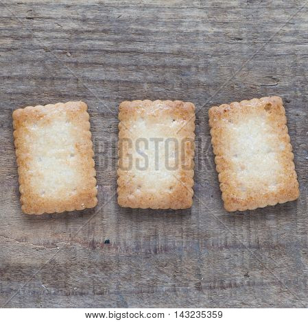 Piece of Mini coconut biscuit on wood table background