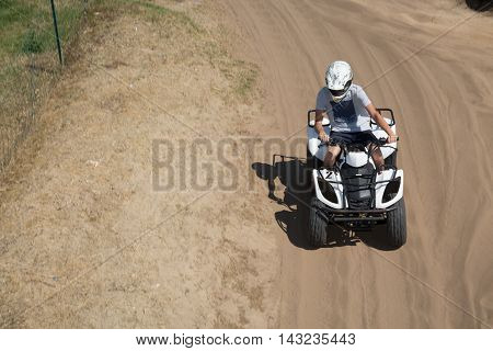 Man driving quad bike enjoying the ride