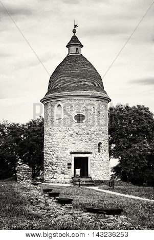 Romanesque rotunda in Skalica Slovak republic. Architectural theme. Cultural heritage. Travel destination. Black and white photo. Vertical composition.