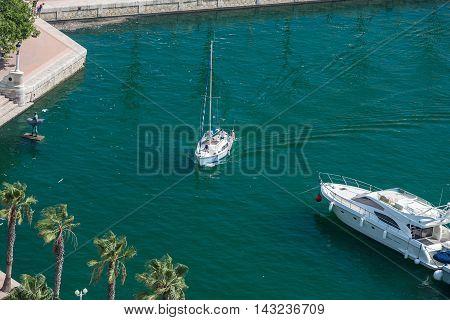 Alicante, Spain - SEPTEMBER 2015: Yacht moving in Alicante Marina