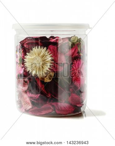 Colourful Potpourri in Plastic Container on White Background