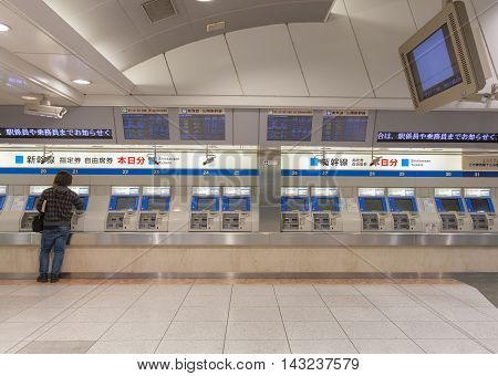 Tokyo Japan - APR 05 2016 : Passengers are buying Shinkansen tickets from vending machines inside Tokyo Station. Passengers can buy any high-speed train passes in Japan from the machine.