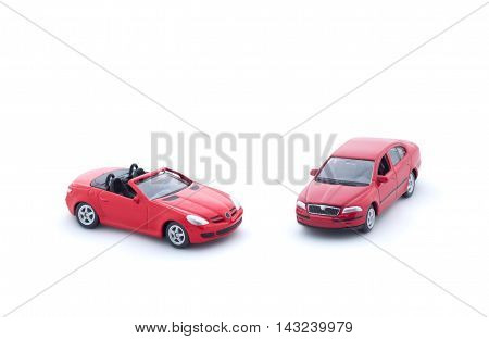 Two Red Toy Cars On White Background, Isolated