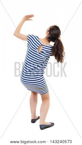back view of woman  protects hands from what is falling from above. woMan holding a heavy load Rear view people collection.  backside view of person.  Isolated over white background. Swarthy girl in a