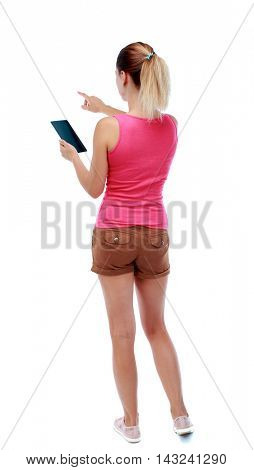back view of pointing young beautiful  woman and using a mobile phone. girl  watching. Rear view people collection.  backside view of person.  Isolated over white background. Sport blond in brown