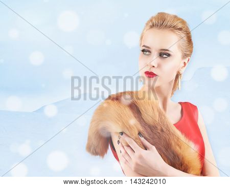 Elegant woman in fur cape on winter background. Luxury lifestyle.