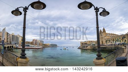 ST.JULIAN'S, MALTA -JUNE 28, 2016: Cloudy day at Balluta Bay at St.Julian's, Malta's popular tourist landmark, Malta.
