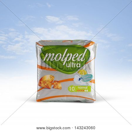 CHISINAU MOLDOVA - August 13. 2016; Pack of 10 Molped Ultra Sanitary Pads on a blue sky background. With clipping path.