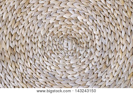 Circular background from rattan fibers wallpaper texture