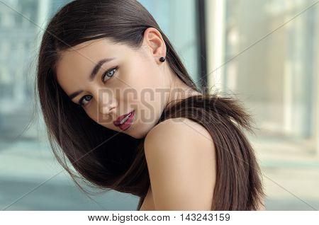 Girl Looks In A Half-turn.
