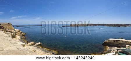 Malta - Panoramic skyline view of Grand Harbour and the entrance of Malta with clear blue sky