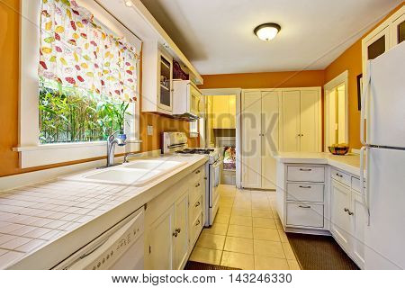 Classic American Kitchen Room Interior With White Cabinets, Tile Floor.