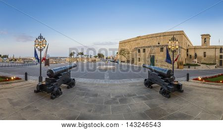 Panoramic shot of the cannons at the entrance of Auberge de Castille, Valletta, Malta