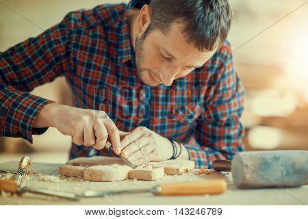 Carpenter at work. Wood engraving ,close up.
