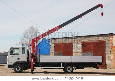 KEMEROVO RUSSIA - MAY 14 2015: great white truck crane standing on a construction site