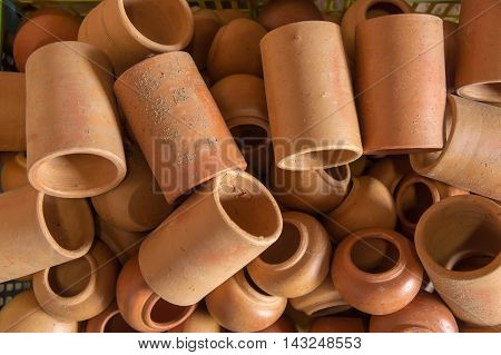 Rustic handmade ceramic clay brown terracotta cups souvenirs at street handicraft marke.