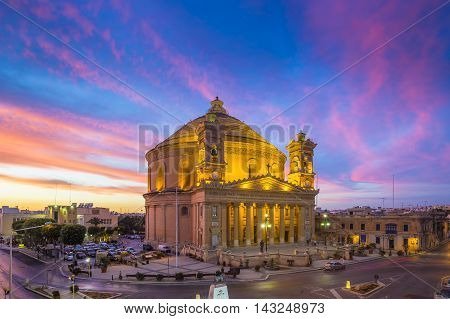 Malta - The famous Mosta Dome with amazing colorful sky at sunset