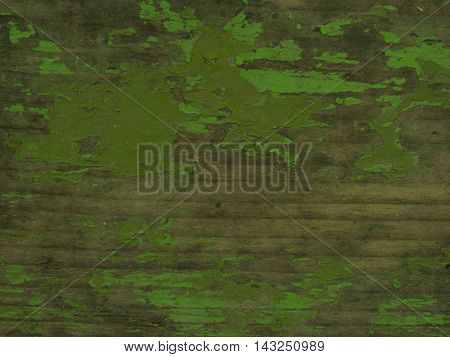 Cracked green paint on a weathered wood plank