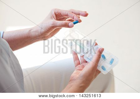 Take pills. Close up of nurse holding box with different pills