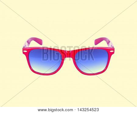 Red sunglasses isolated over the yellow background