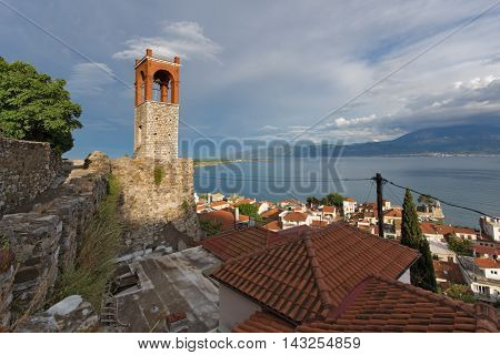 Amazing seascape with Clock tower in Nafpaktos town, Western Greece