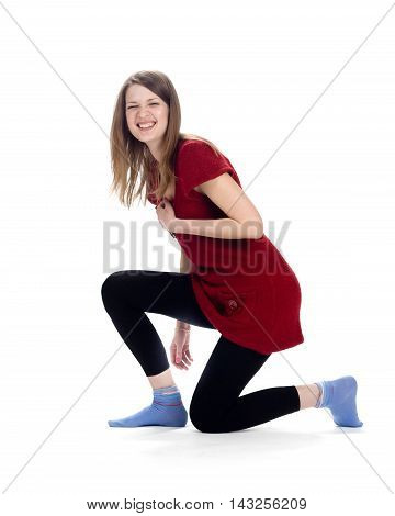 Laughing woman standing on one knee on white background