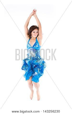 Yung jumping girl in a dress on white background