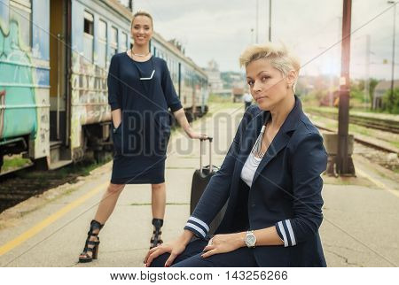 Business People With Suitcase Posing On The Railway Station