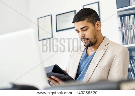 Cropped shot of a young businessman in his office
