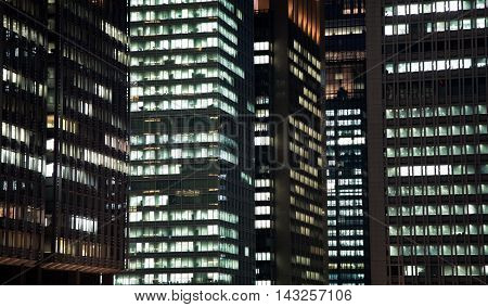 Detail of the architecture of Tokyo at night. Buildings in the Ginza Financial district.