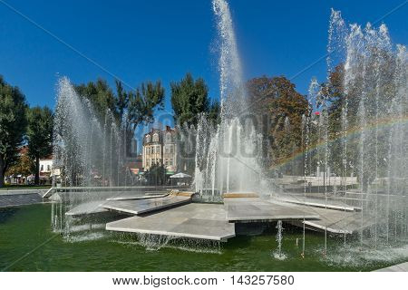 Panoramic view of Fountain and rainbow in the center of City of Pleven, Bulgaria