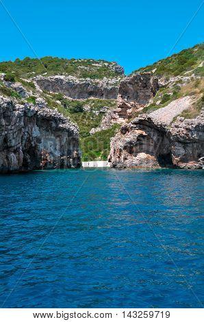 Sea view to small lagoon beach on mountains island