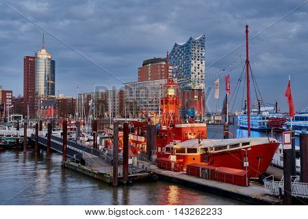 HAMBURG, GERMANY - MARCH 27, 2016: The red fire patrol boat in the marina of Hamburg with its restaurant waits for guests who want to enjoy dining in a maritime environment.