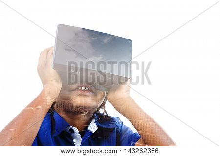 Boy wearing virtual reality simulator against aerial view of a city on a cloudy day