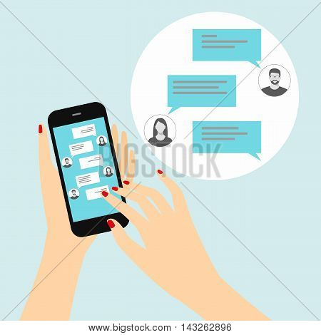 Sending messages to friends via instant messaging. Female hand holding a smartphone with a chat on the display