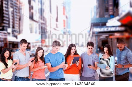Four friends standing to the side slightly sending texts against blurry new york street