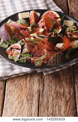 Salad With Figs And Parma Ham Dressed With Balsamic Sauce. Vertical
