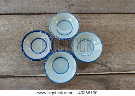empty plate on wood background, old plate