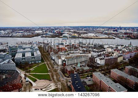 HAMBURG, GERMANY - MARCH 27, 2016: Scenic panorama over Landungsbruecken, musical halls, river Elbe, and docks in Hamburg-